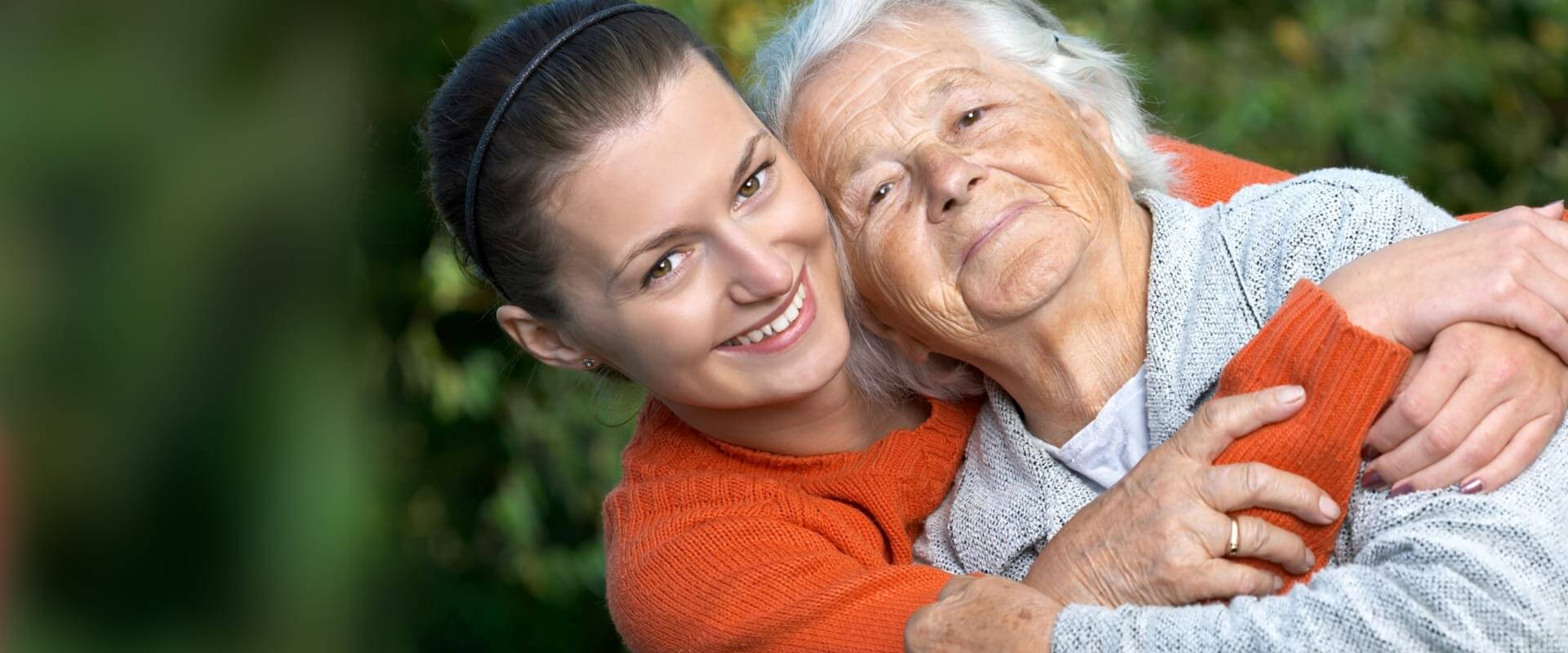 old woman smiling with a young woman