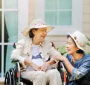 elder woman on a wheelchair with a woman